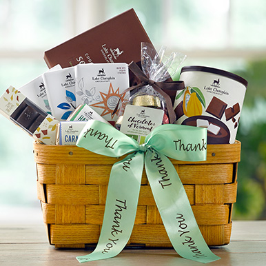 Gift basket filled with assorted gourmet chocolates with a green thank you ribbon