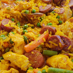 Paella cooked with chicken, chorizo & vegetables