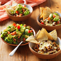 Nachos topped with beef or chicken plus black beans, guacamole, sour cream & lettuce