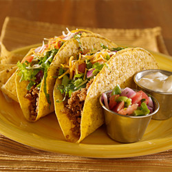 Duo of tacos, filled with shredded beef, chicken or veggies plus lettuce, cheese, guacamole & sour cream.