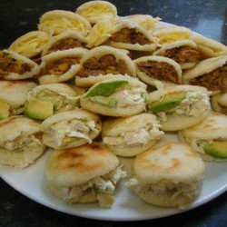 Mini arepas (white corn pockets) filled with shredded beef & manchego cheese, chicken & avocado, or sweet plantain & grilled haloumi cheese