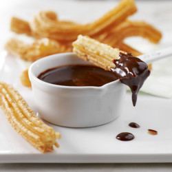 Churros with cinnamon and chocolate or caramel sauce