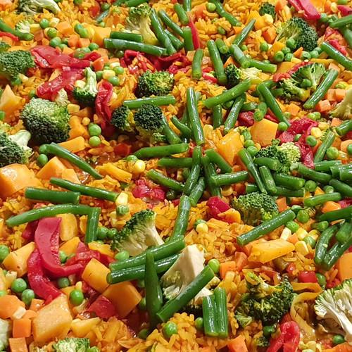 Paella cooked with broccoli, artichokes, capsicum, tomatoes, leek, pumpkin & peas
