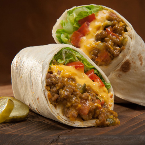 Burritos filled with shredded beef, chicken or veggies plus lettuce, black means, rice, cheese, and sour cream