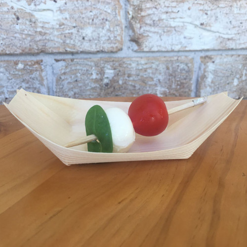 Mini caprese, cherry tomatoes with bocconcini and basil