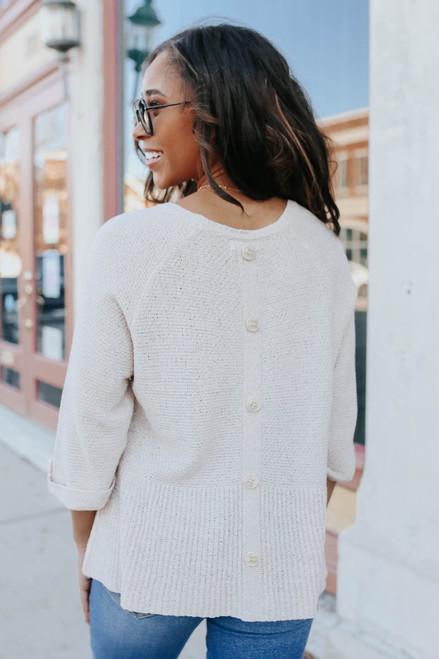 Roll Tab Beige Peplum Sweater