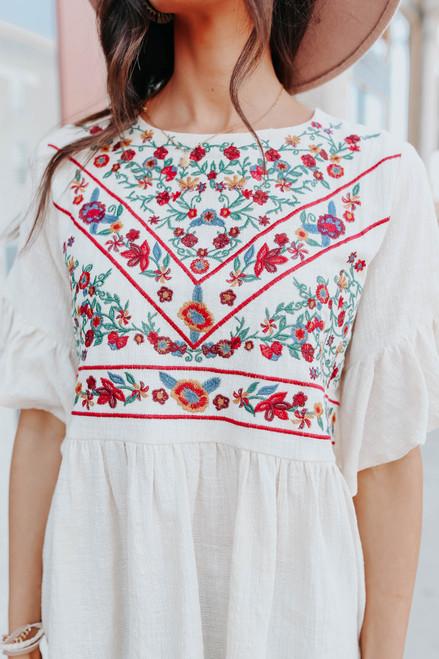 Ruffle Sleeve Embroidered Peplum Top
