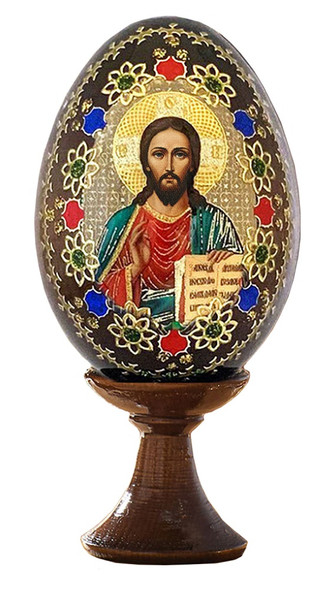 Small wood egg on stand featuring Christ Blessing icon and gold ornamentation.