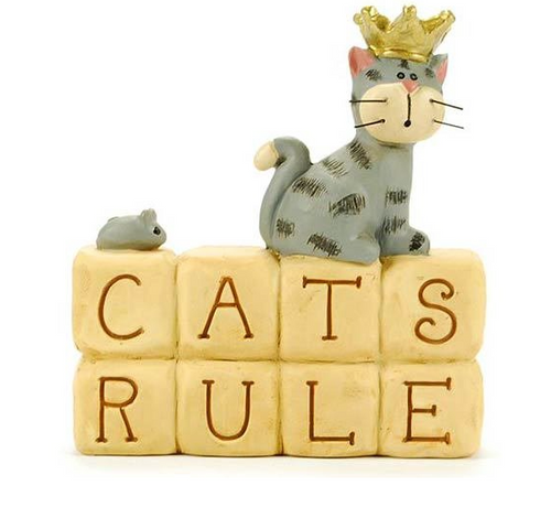 """This hand-painted cast resin figurine features cat on blocks that read, """"Cats Rule"""". The cats have wire whiskers. Measures approx 2.5"""" x 2.75""""."""