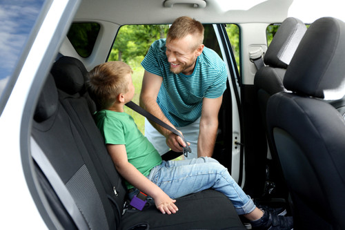Buckle Booster™ in use buckling in a child.