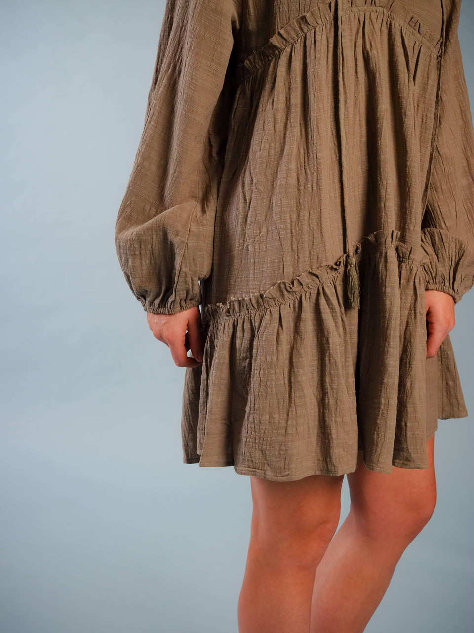 Olive green, Lightweight long-sleeve, Prairie-Style dress that could also be worn as a tunic, Model is wearing a small.