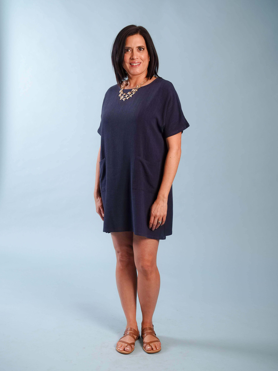Lightweight navy linen-blend dress, Short sleeves, Front pockets, Model is wearing a small.