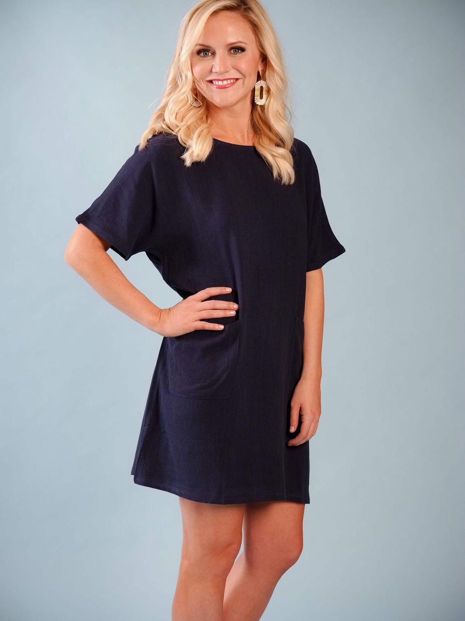 Lightweight navy linen-blend dress, Short sleeves, Front pockets, Model is wearing a small.