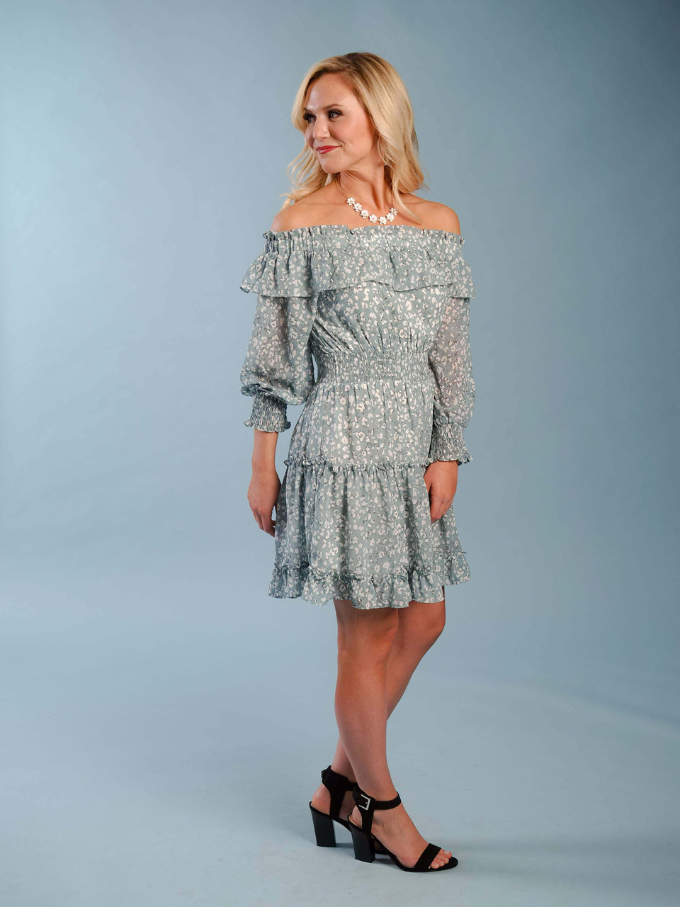 Lightweight feminine off-the-shoulder lined prairie-style dress, Model is wearing a small.