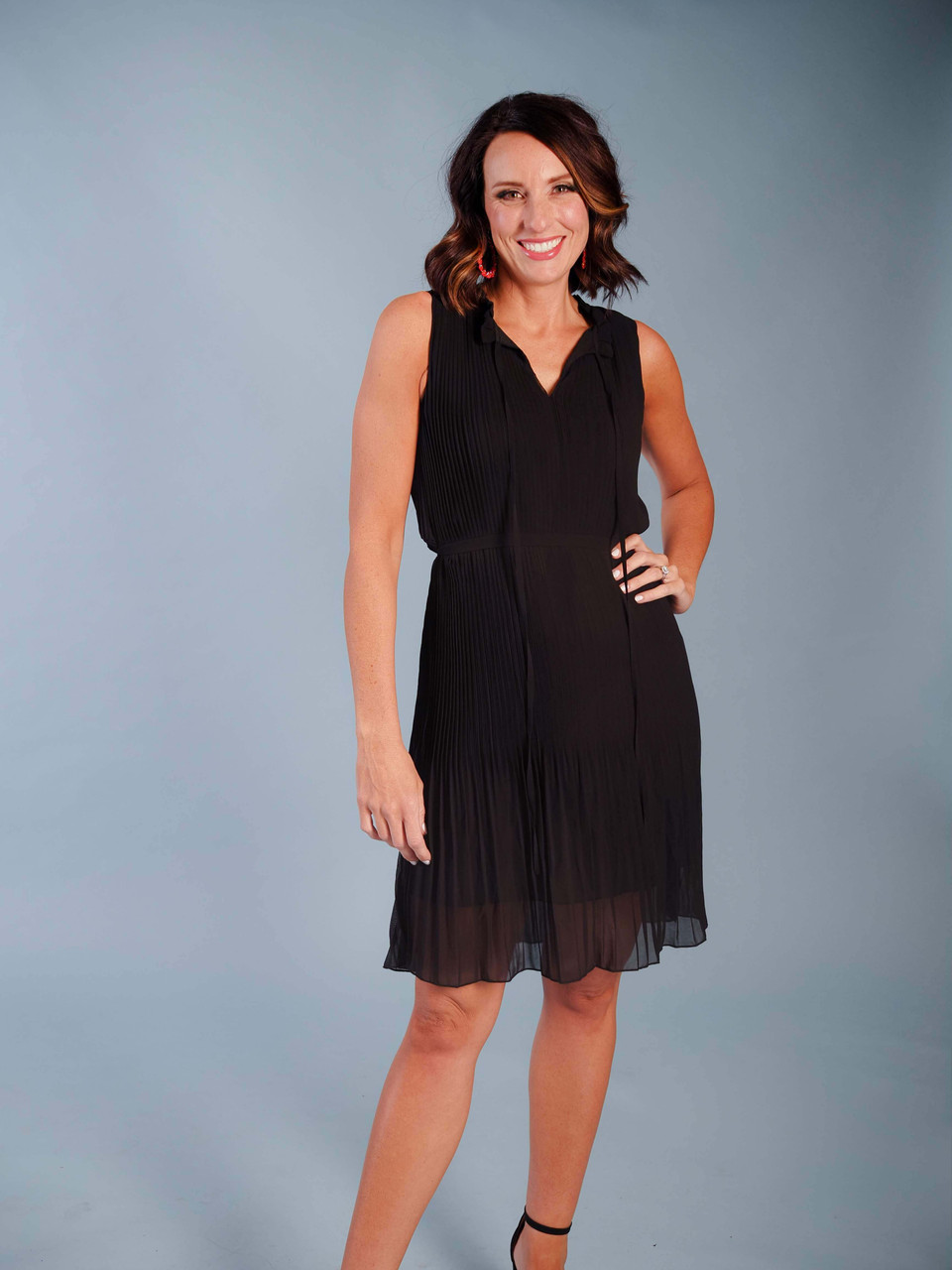 Lightweight sleeveless LBD, Delicate pleating detail, Lined, V-Neck with tie detail, Tie waist, Model is wearing a small.