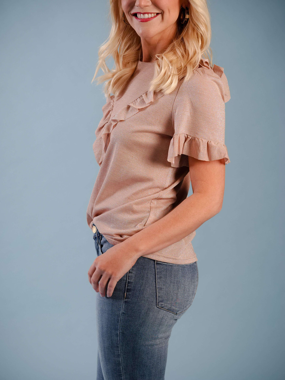 Soft shimmery rose gold short sleeve blouse, Ruffle front and sleeve detail, Model is wearing a small.