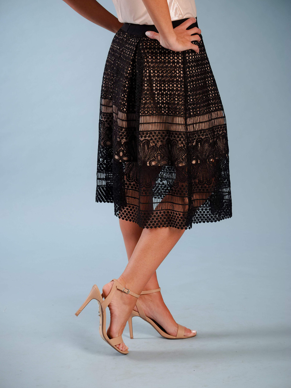 Feminine midi skirt with Guipure Lace overlay, Knee length nude shimmer contrasting lining, Elastic waist with back zipper, Model is wearing a small.
