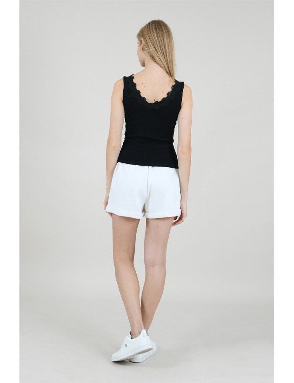 Fitted black tank, Lace detail on neckline,  V-neck front and back, Model is wearing a S/M.