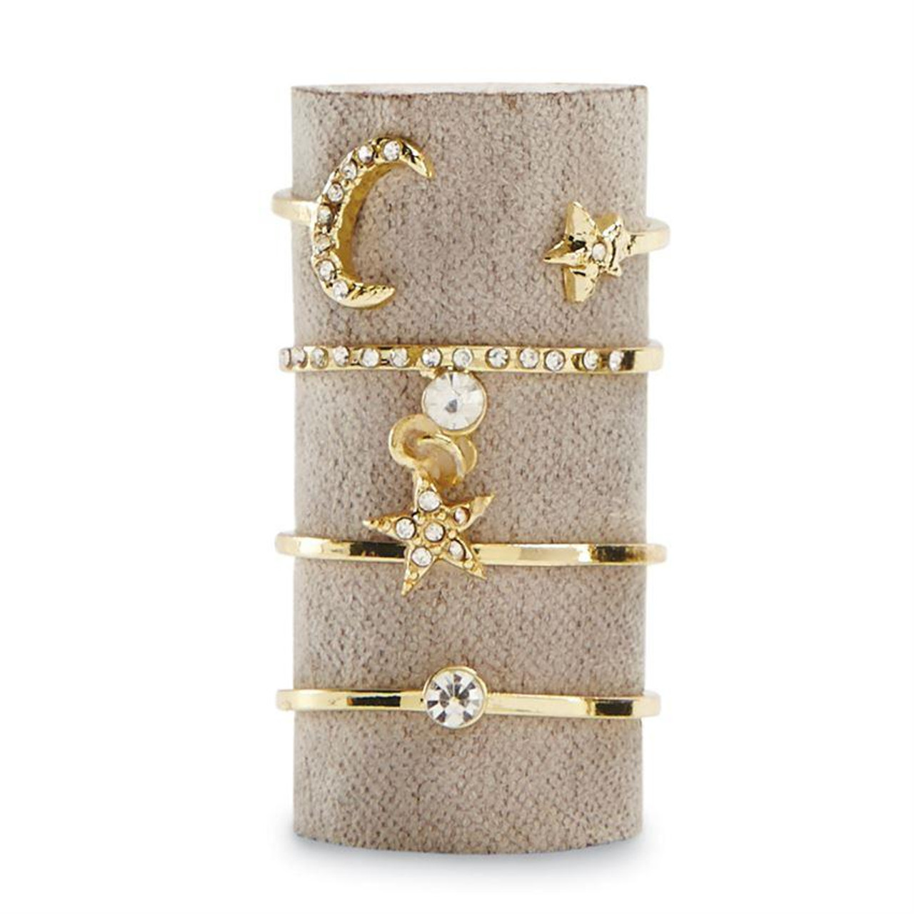 Set includes four different adjustable gold metal rings with pave accents. Ring sets arrive stacked on velvet in corked glass vial.