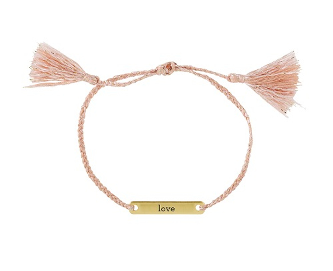 Joy In A Jar bracelets are delicately woven with a simple phrase stamped onto a brass bar, packaged inside a glass jar.