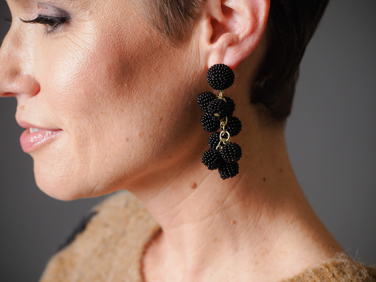 Beaded bauble drop earrings feature hypoallergenic posts. Available in BLACK or WHITE.
