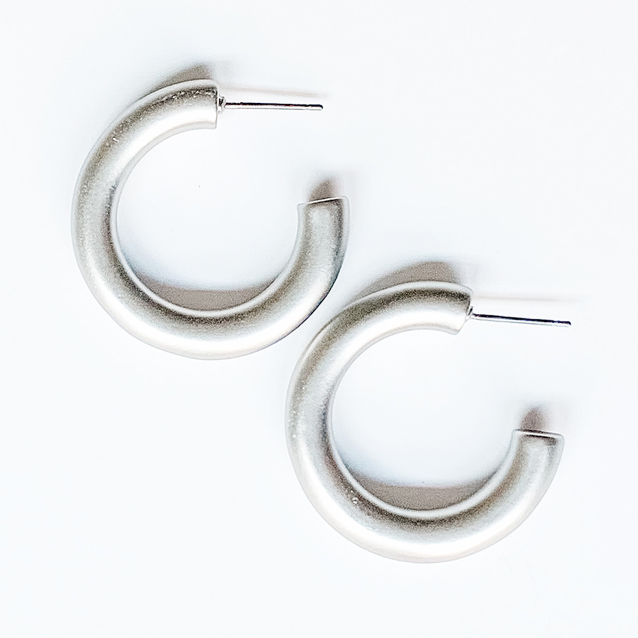 Thick silver metal hoop earrings, Nickel and lead free.