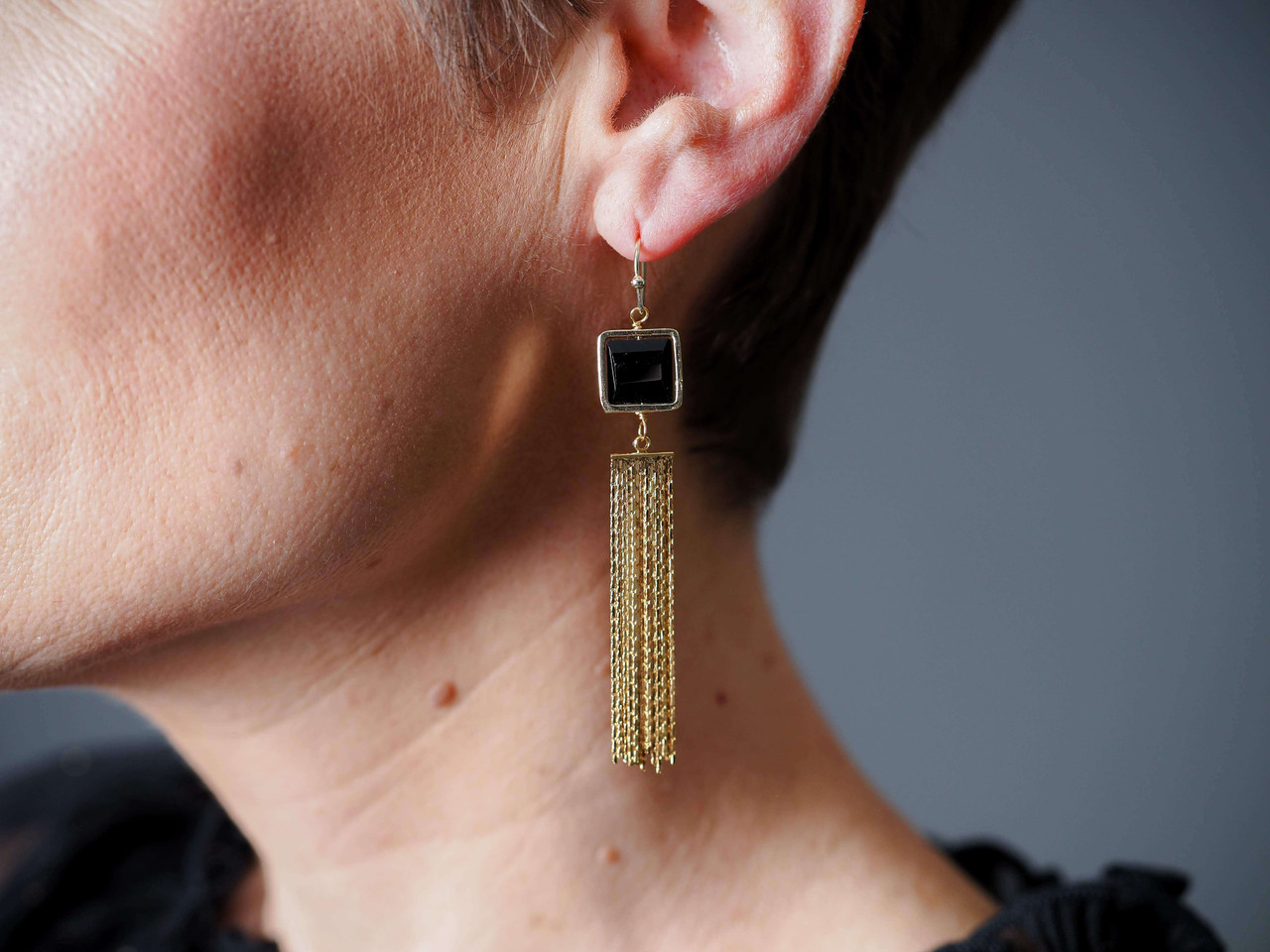 Gold metal tassel earrings with black square stone, Nickel and lead free.