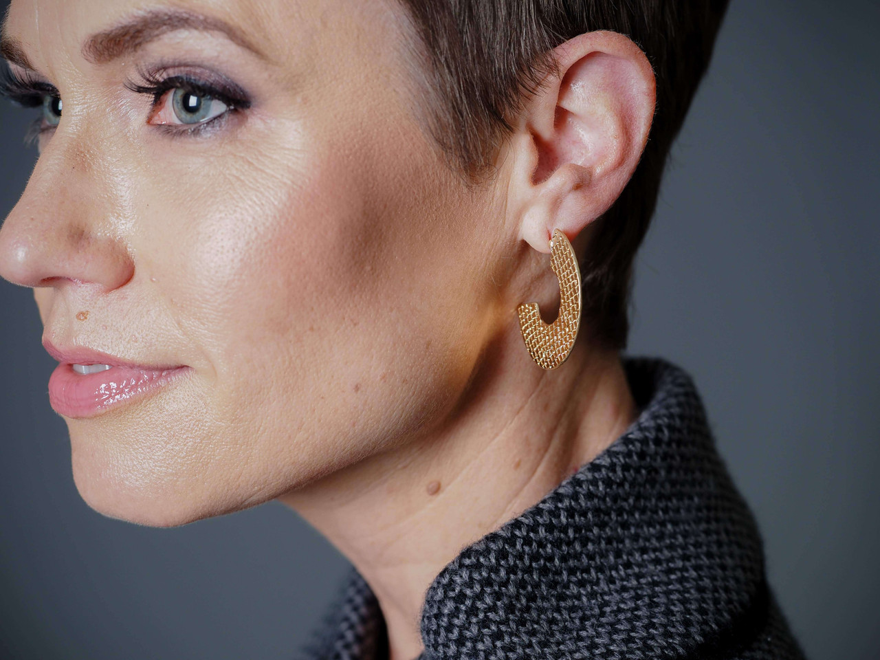 Gold snakeskin textured metal earrings, Nickel and lead free.