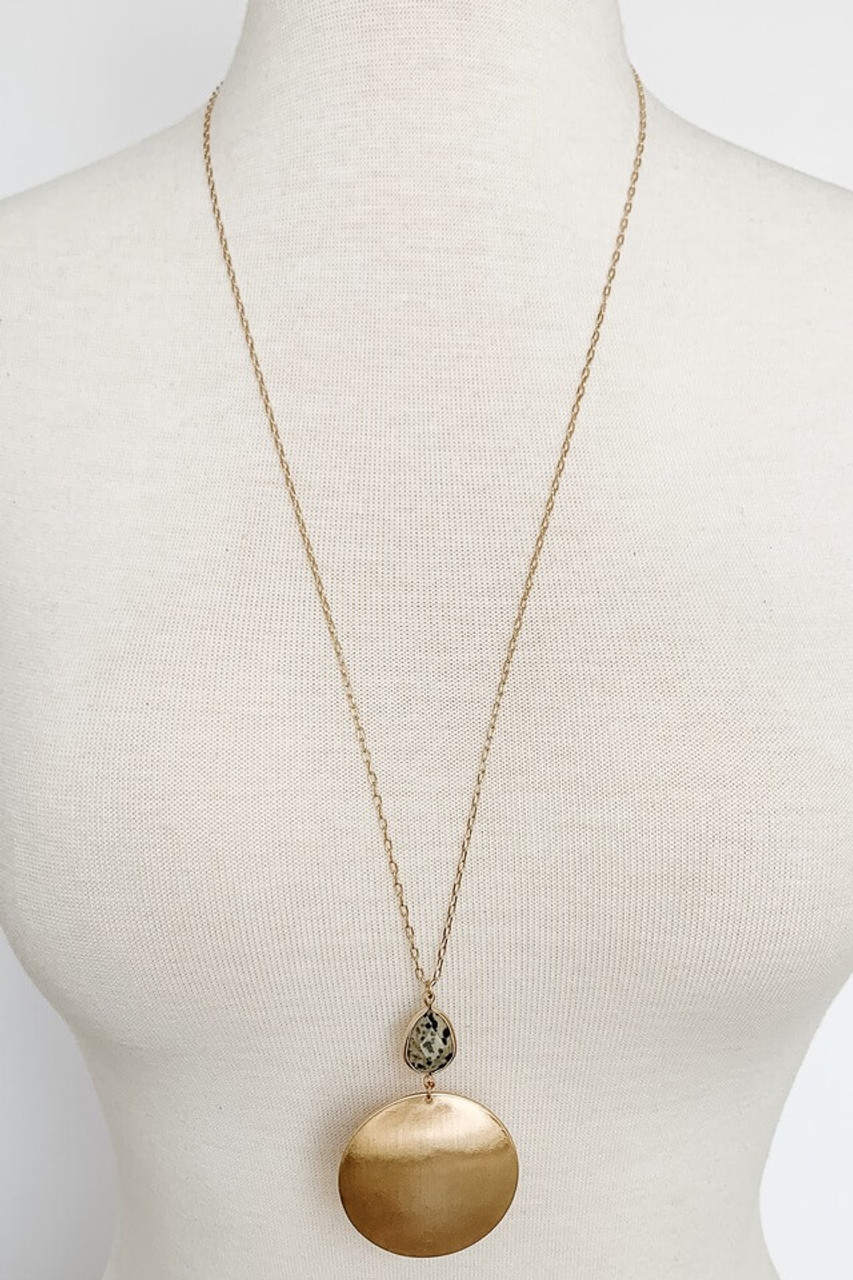 Long necklace with gold metal circle and Dalmatian stone pendant, Nickle and lead free.
