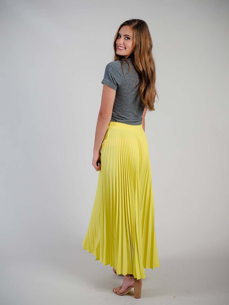 long neon yellow pleated skirt
