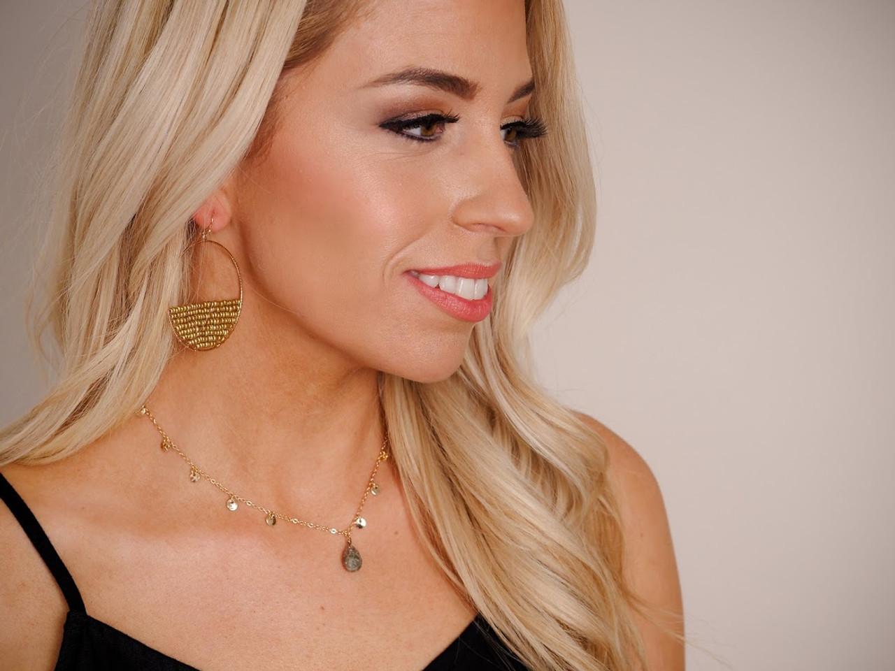 Woman in Black Tanktop Models Gold Jewelry