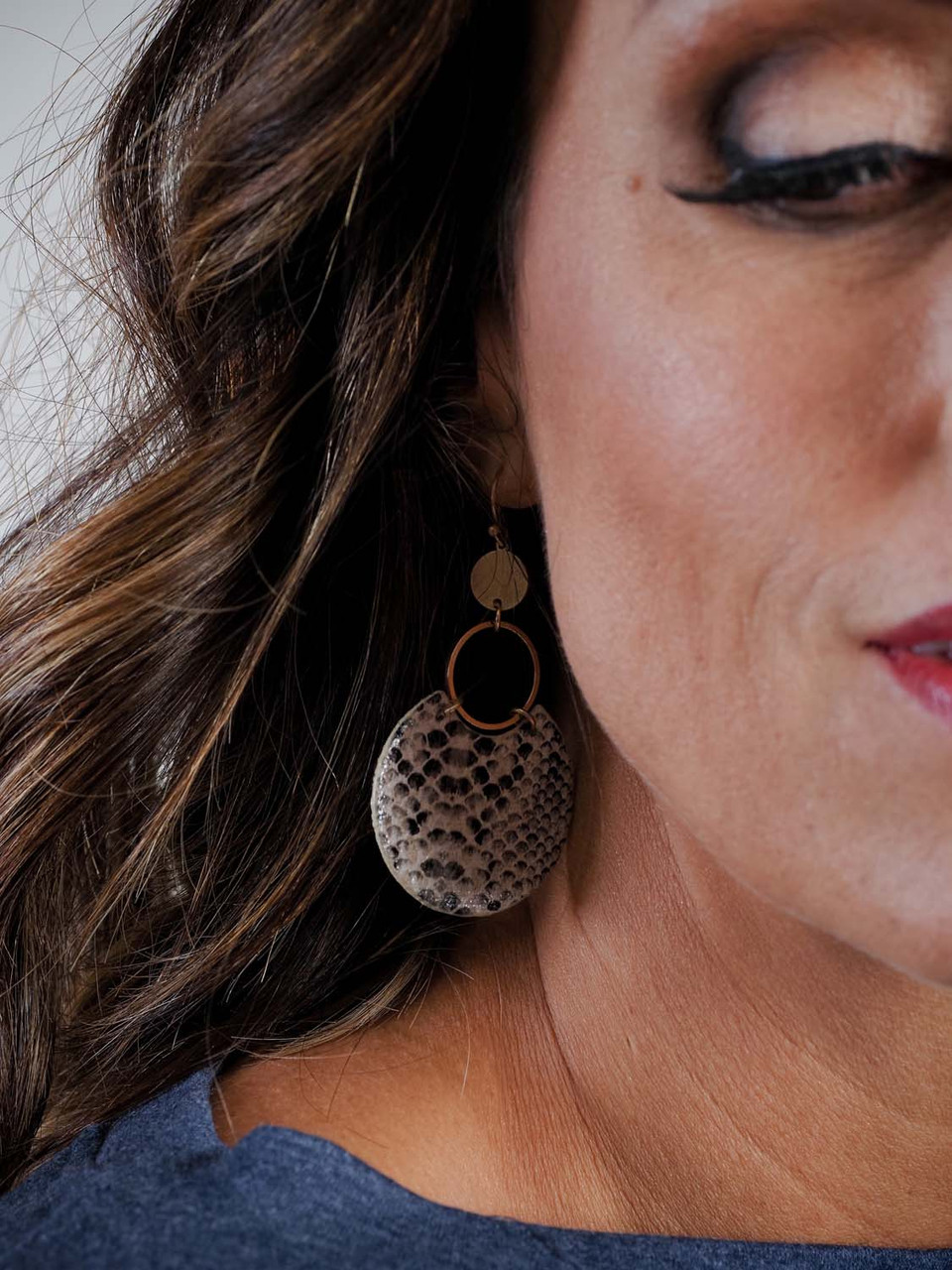 snake print and gold drop earring