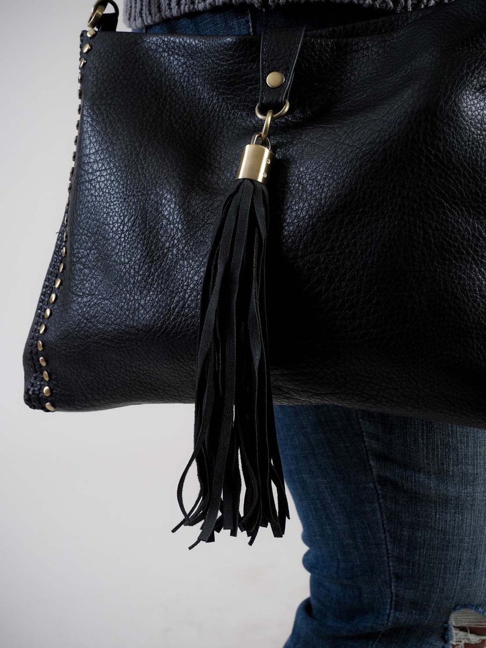black crossbody bag with tassel