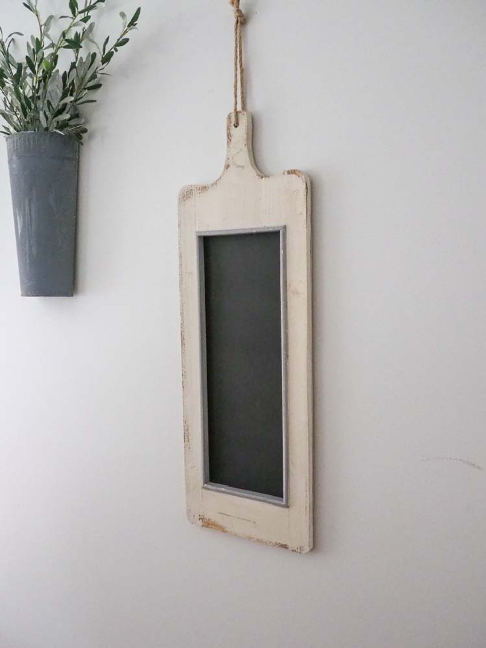 white washed menu board with chalkboard