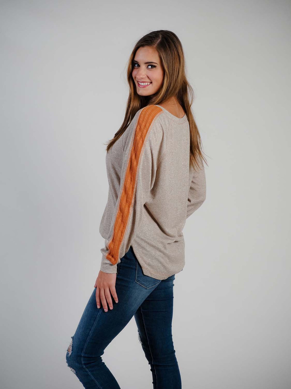 taupe jersey knit top with rust band sleeve