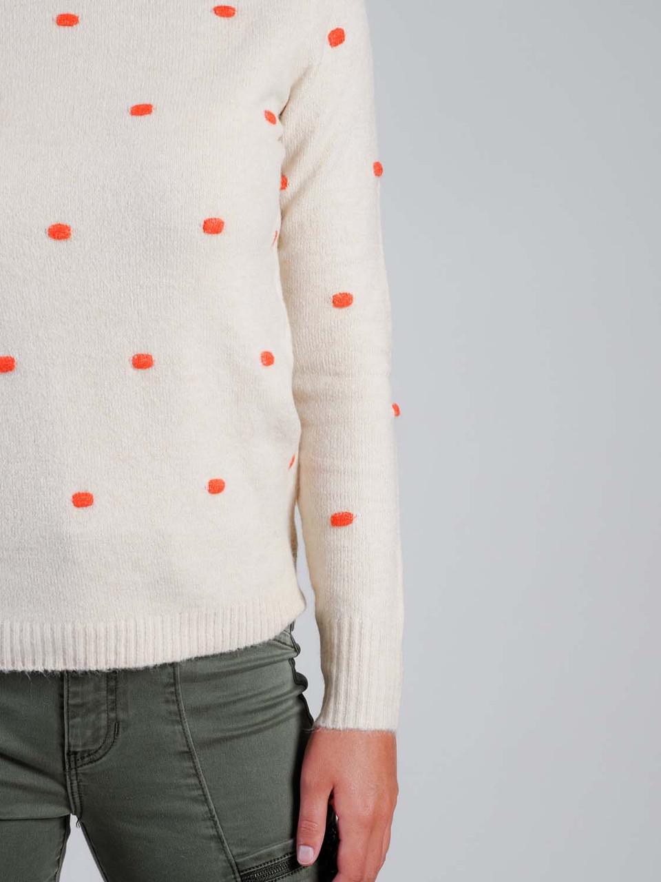 Cream sweater with orange pom pom detail