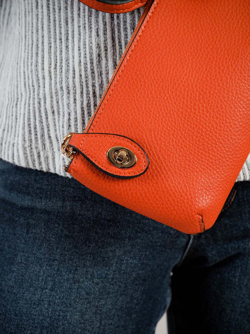 kendall crossbody wristlet in orange jen and co
