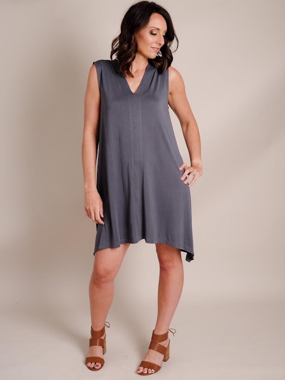 Woman Models Knee-Length, Sleeveless Gray Dress