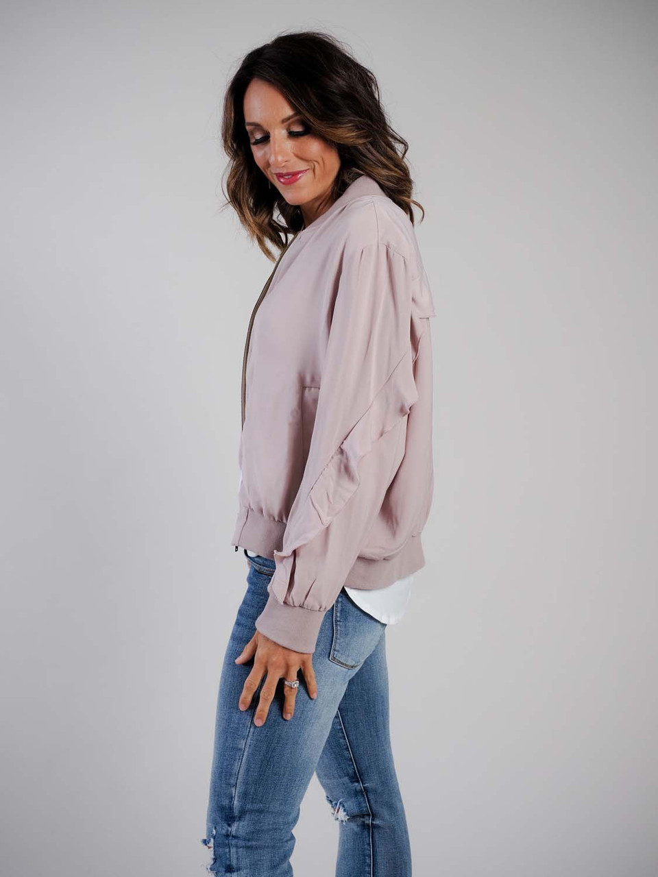 blush bomber jacket with ruffle detail mudpie
