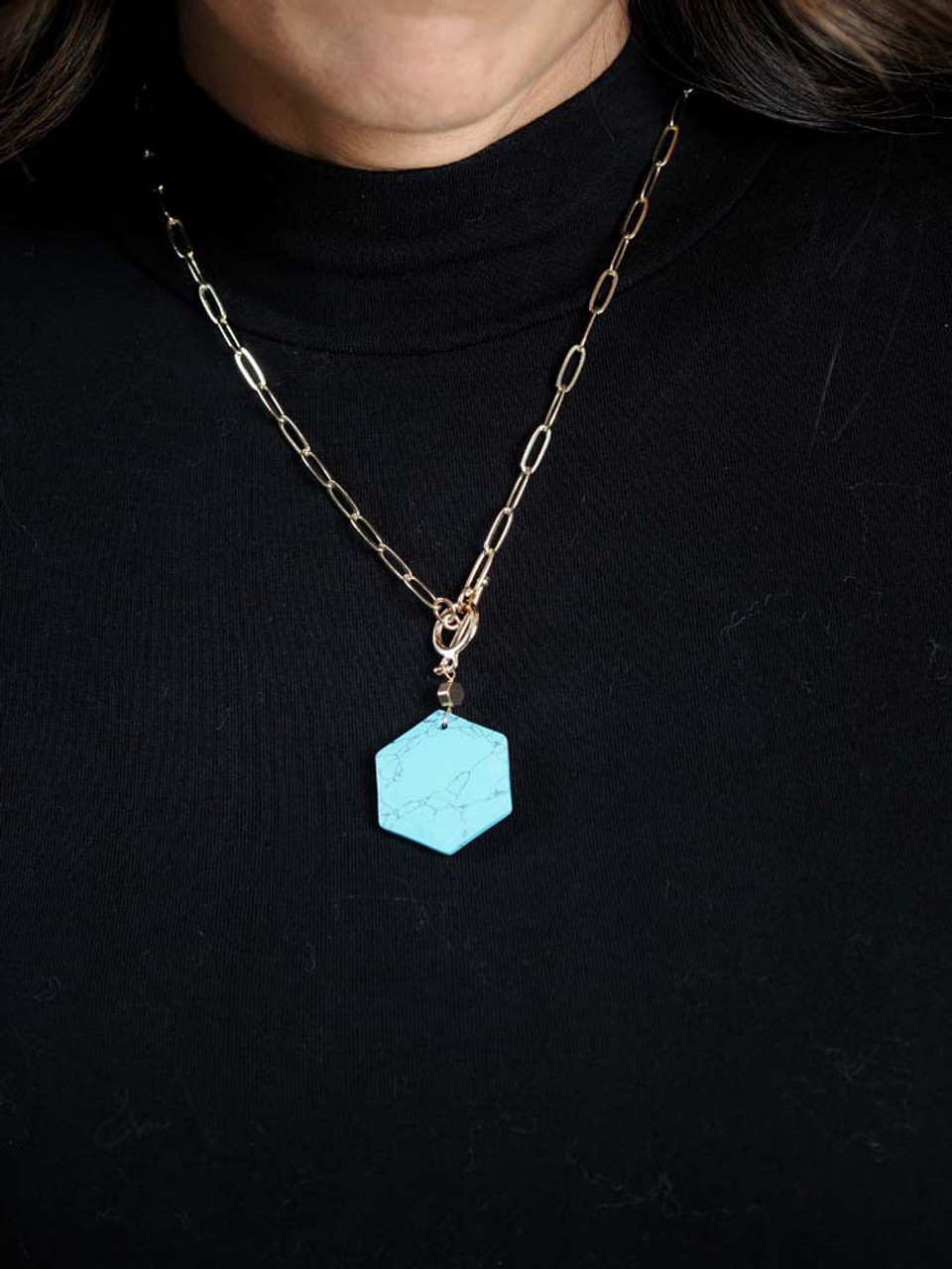 gold link necklace with turquoise pendant