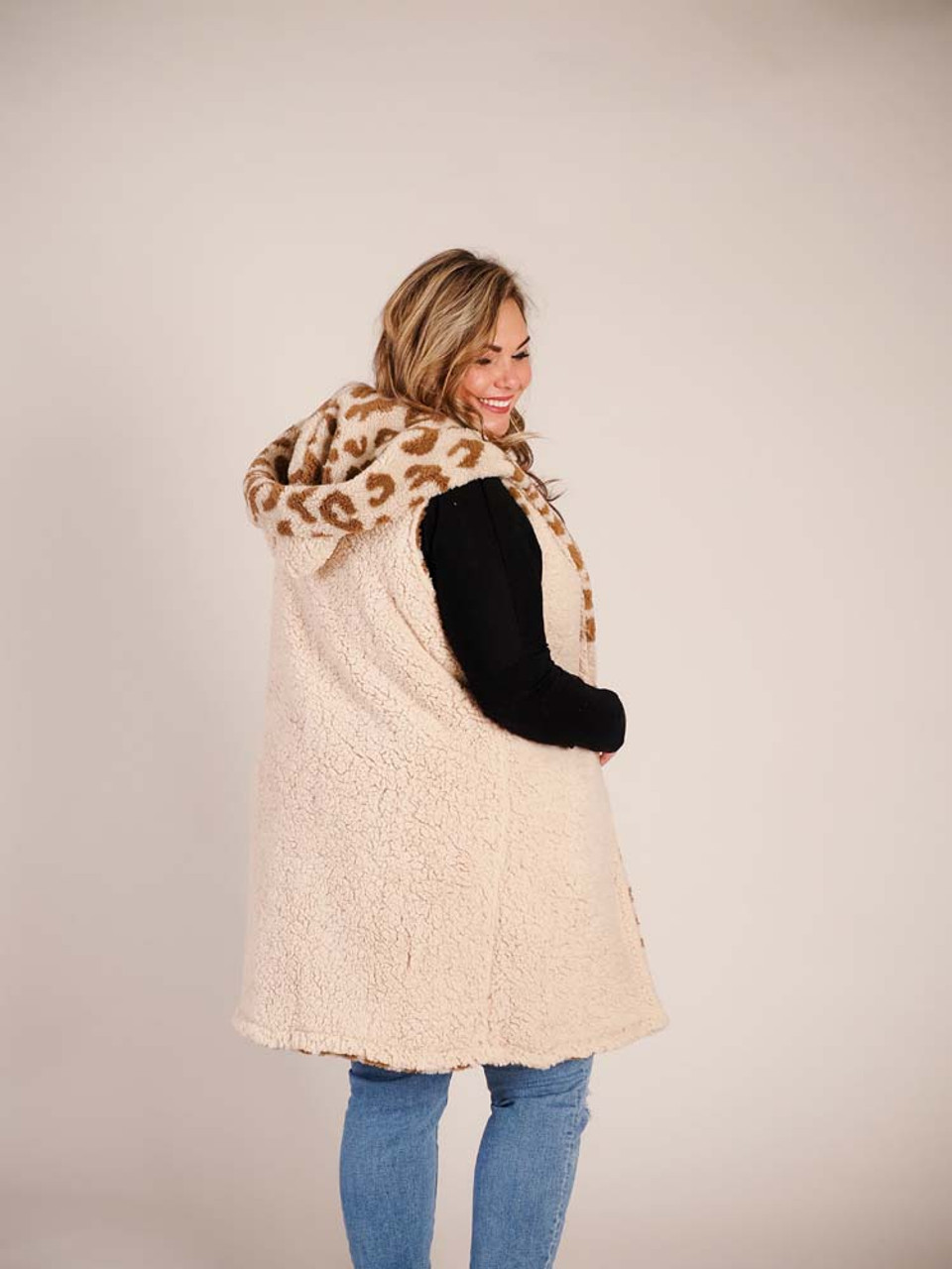 Reversible long vest with leopard print and hood