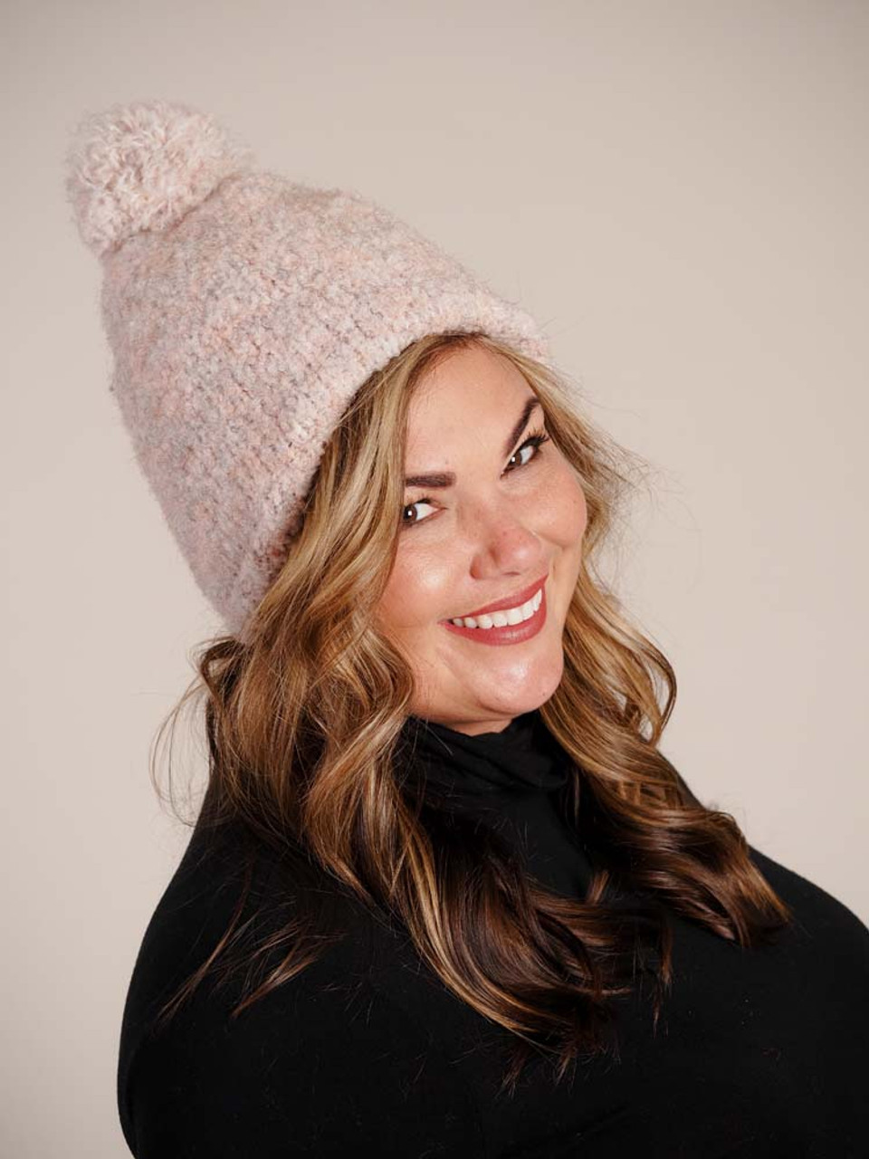 pink multicolor hat with pom pom