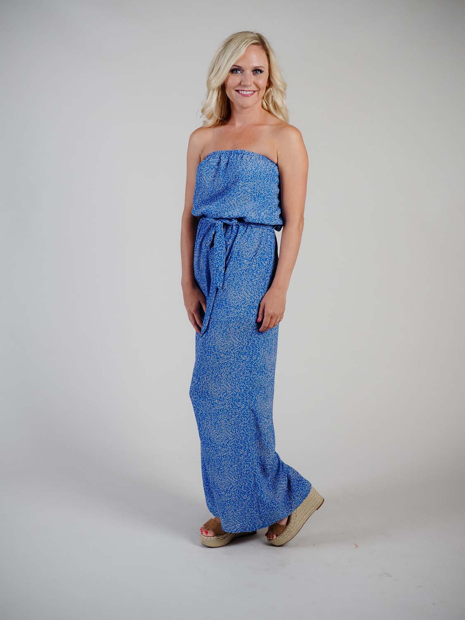 blue strapless jumpsuit with belted waist