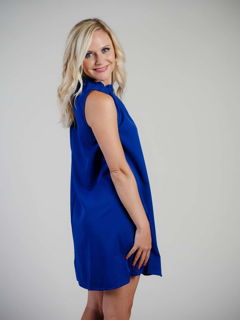royal blue mini dress with ruffled neckline