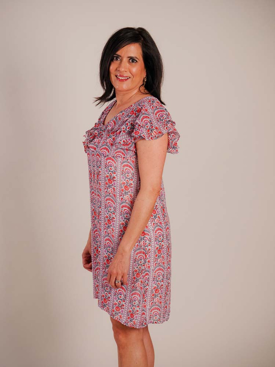 Midi dress with ruffled layers at top and short butterfly sleeves. Red, navy, and purple floral vertical striped design on grey background. Body of dress is fully lined