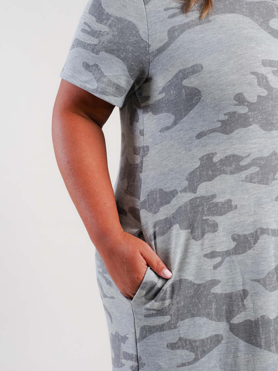 Soft light weight t-shirt dress with gray camo design. Round colar, short sleeves, side pockets at seams, and rounded t-shirt cut at bottom