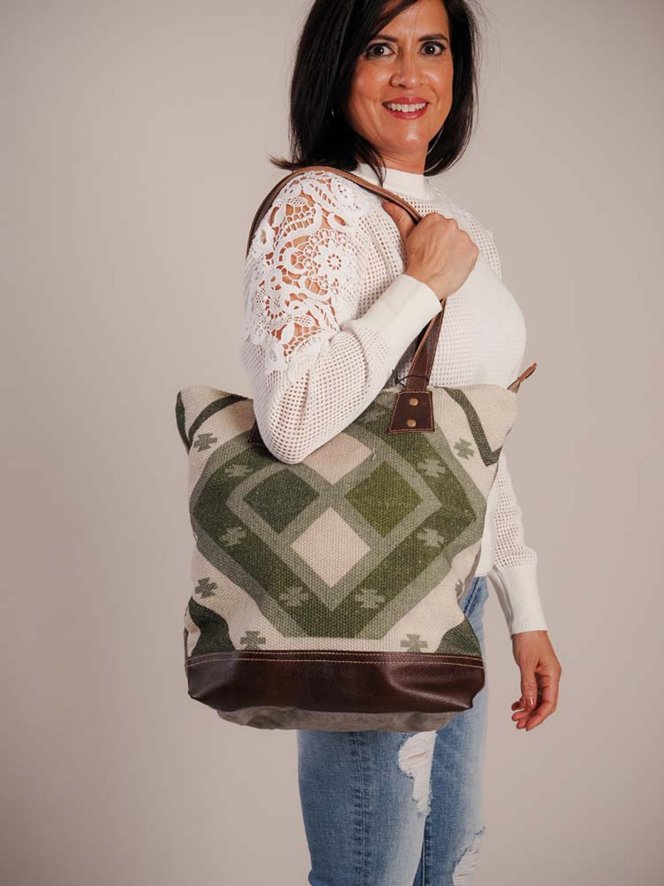unique handwoven rug, this tote bag is both functional and fashionable. The beautiful combination of colors gives it an earthy charm. Zipper close at top, outside zipper pocket on back, interior has a zipper pocket on one side and two slip pockets