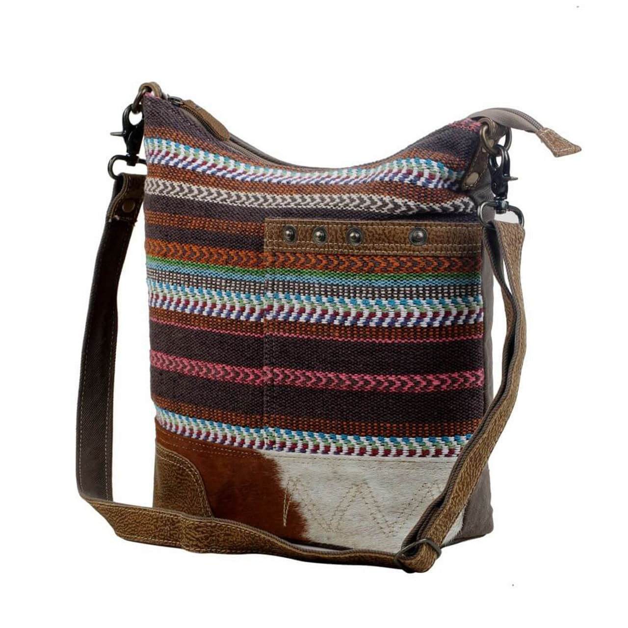 Upcycled from a unique hand-woven rug, this all-purpose shoulder bag is perfect for everyday use. Gray/Olive denim back. Zipper close at top, slip pocket on front, zipper pocket on back; interior is fully lined and has one zipper pocket and two slip pockets.