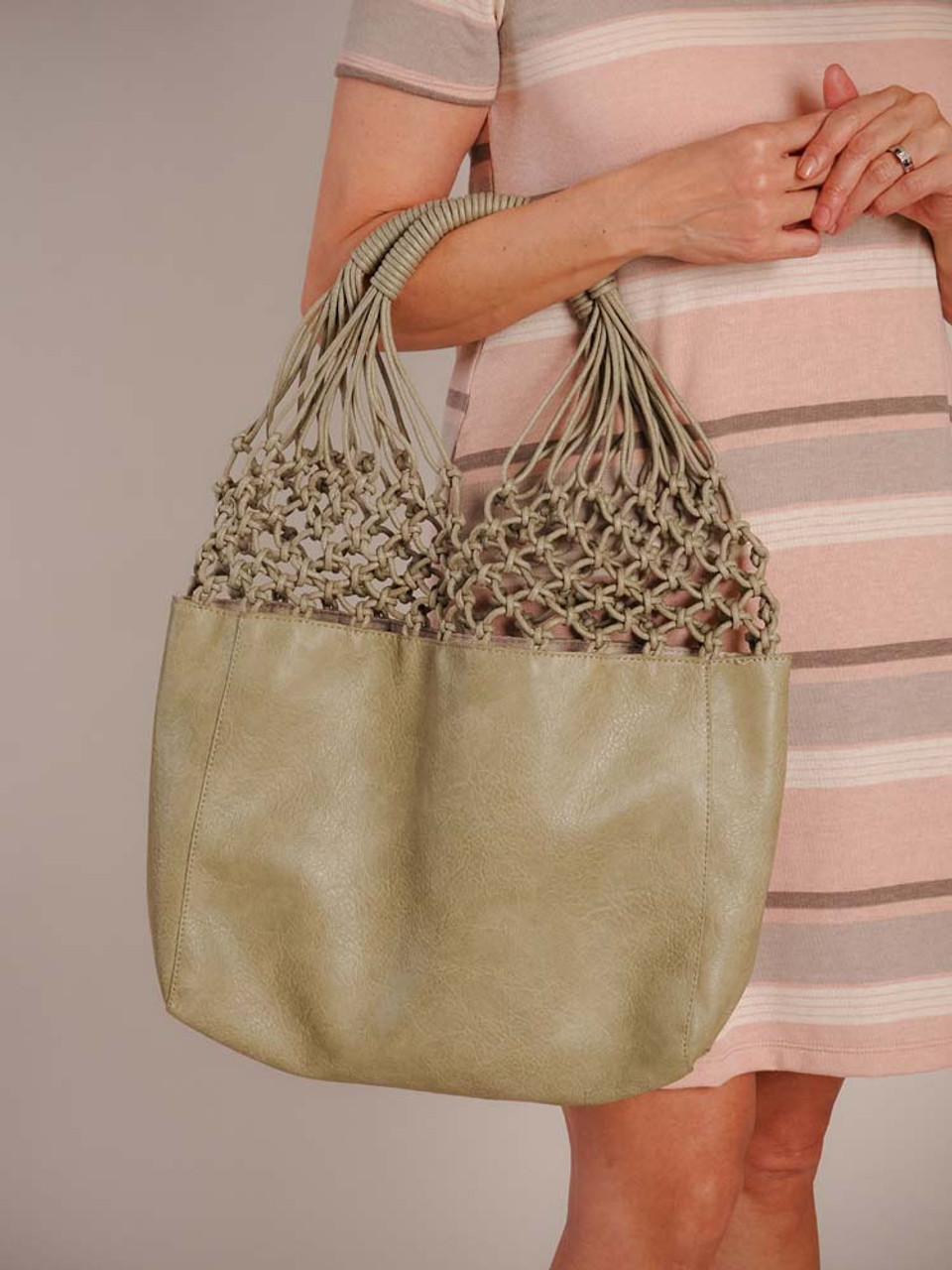 This go-to summer bag has a perfect netting and vegan leather combination! Includes an inner bag with two slip pockets, zipper pocket, and zipper close. Tote and inner bag are both fully lined.