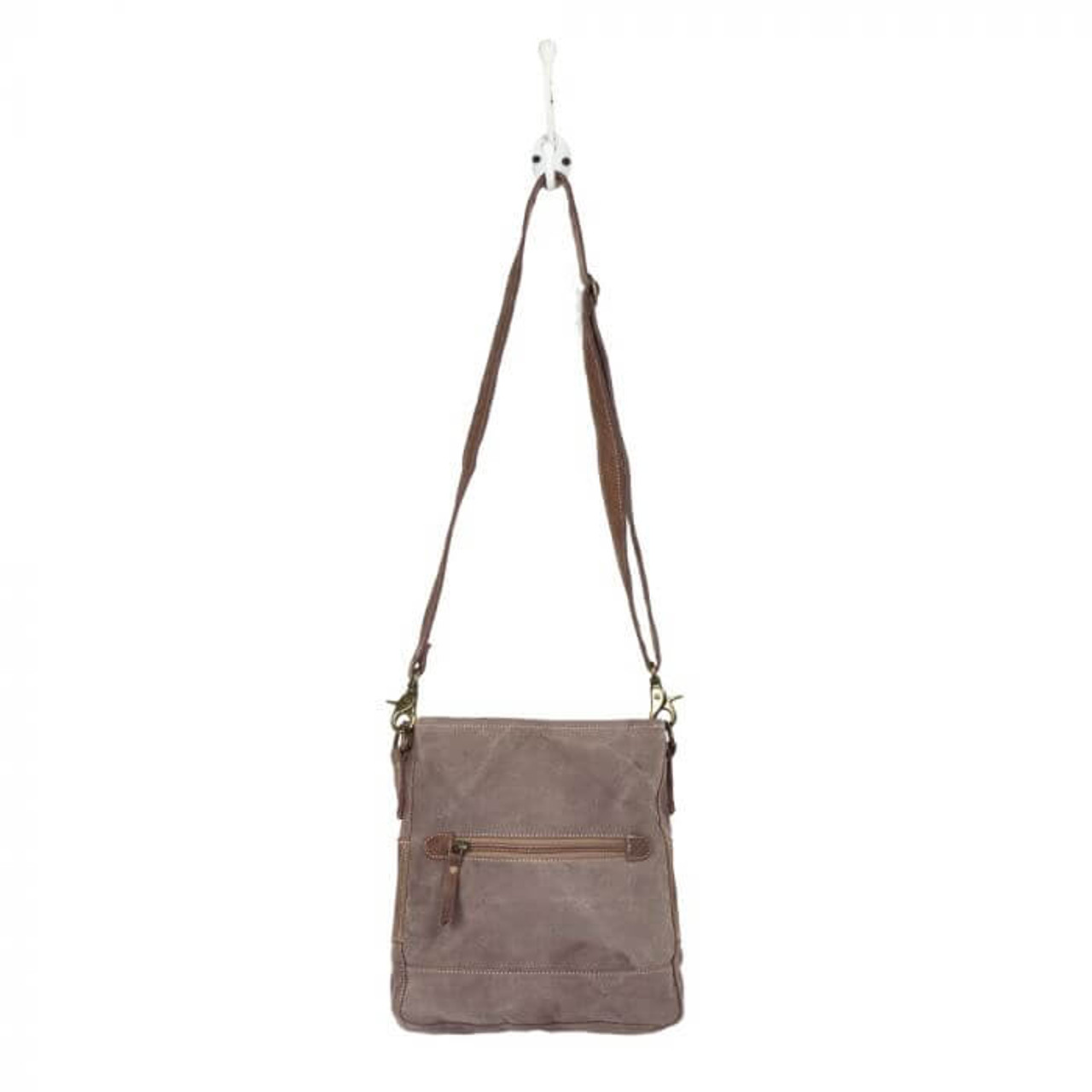 This canvas bag has chic fashion floral print pattern with hairon at the front bottom and leather details! This bag features one back pocket and zippered top closure to secure items inside and an adjustable canvas lined leather cross-body strap. Inside is fully lined and has two slip pockets and a zipper pocket.